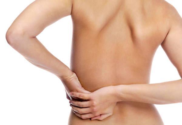 Какая связь межу запором и болью в спине