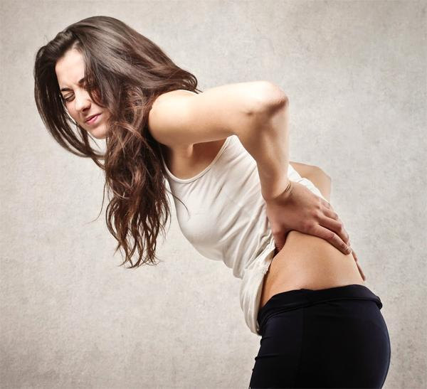 Боль в спине во время овуляции